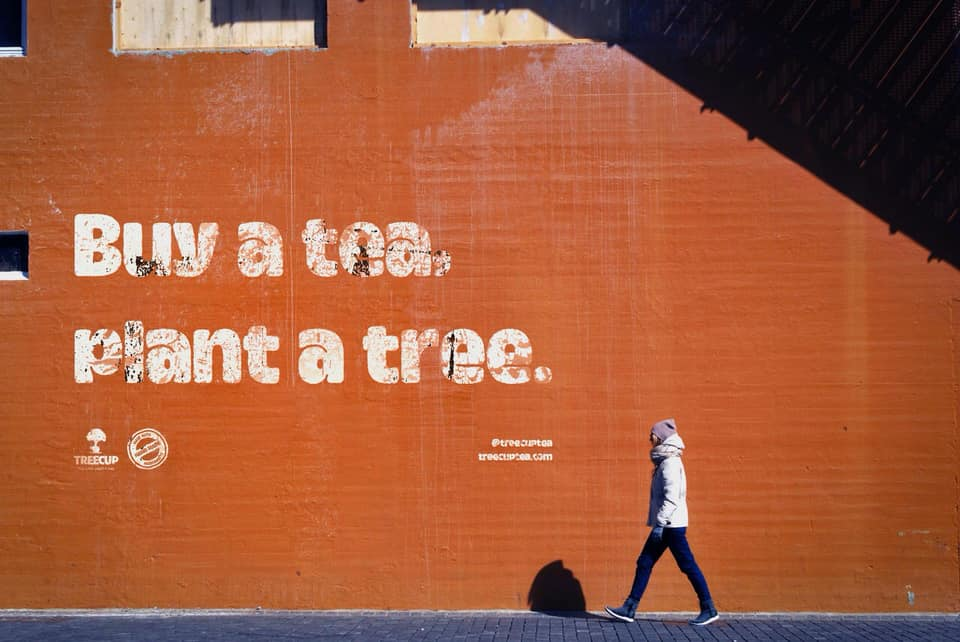 Buy A Tea, Plant A Tree spraypainted